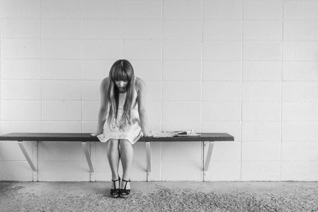 depressed girl sitting